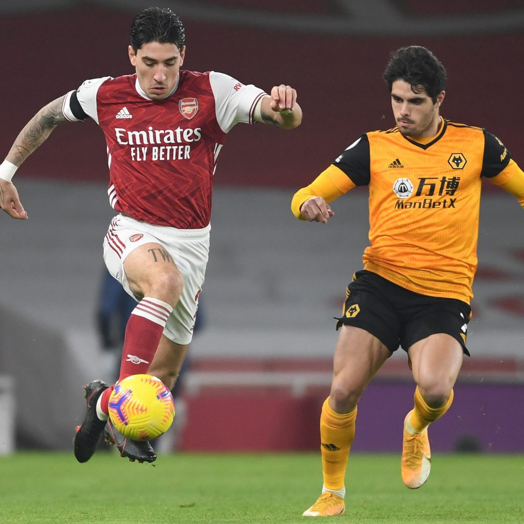LONDON, ENGLAND - NOVEMBER 29: Hector Bellerin of Arsenal takes on Pedro Neto of Wolves during the Premier League match between Arsenal and Wolverhampton Wanderers at Emirates Stadium on November 29, 2020 in London, England. Sporting stadiums around the UK remain under strict restrictions due to the Coronavirus Pandemic as Government social distancing laws prohibit fans inside venues resulting in games being played behind closed doors. (Photo by David Price/Arsenal FC via Getty Images)