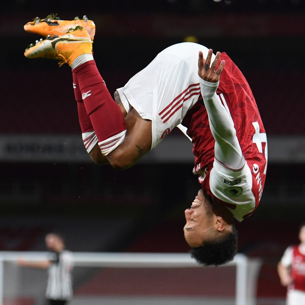 LONDON, ENGLAND - JANUARY 18: Pierre-Emerick Aubameyang celebrates scoring Arsenal's 1st goal with his team mates during the Premier League match between Arsenal and Newcastle United at Emirates Stadium on January 18, 2021 in London, England. Sporting stadiums around England remain under strict restrictions due to the Coronavirus Pandemic as Government social distancing laws prohibit fans inside venues resulting in games being played behind closed doors. (Photo by David Price/Arsenal FC via Getty Images)
