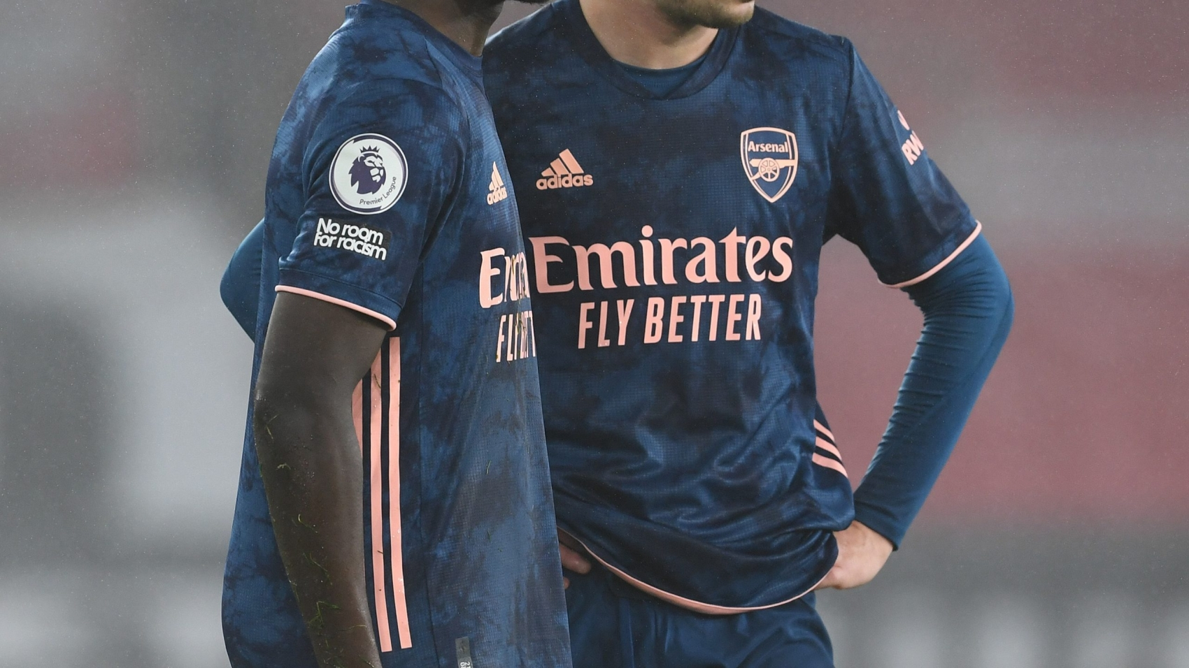 SOUTHAMPTON, ENGLAND - JANUARY 26: (L-R) Bukayo Saka and Emile Smith Rowe of Arsenal during the Premier League match between Southampton and Arsenal at St Mary's Stadium on January 26, 2021 in Southampton, England. Sporting stadiums around the UK remain under strict restrictions due to the Coronavirus Pandemic as Government social distancing laws prohibit fans inside venues resulting in games being played behind closed doors. (Photo by Stuart MacFarlane/Arsenal FC via Getty Images)
